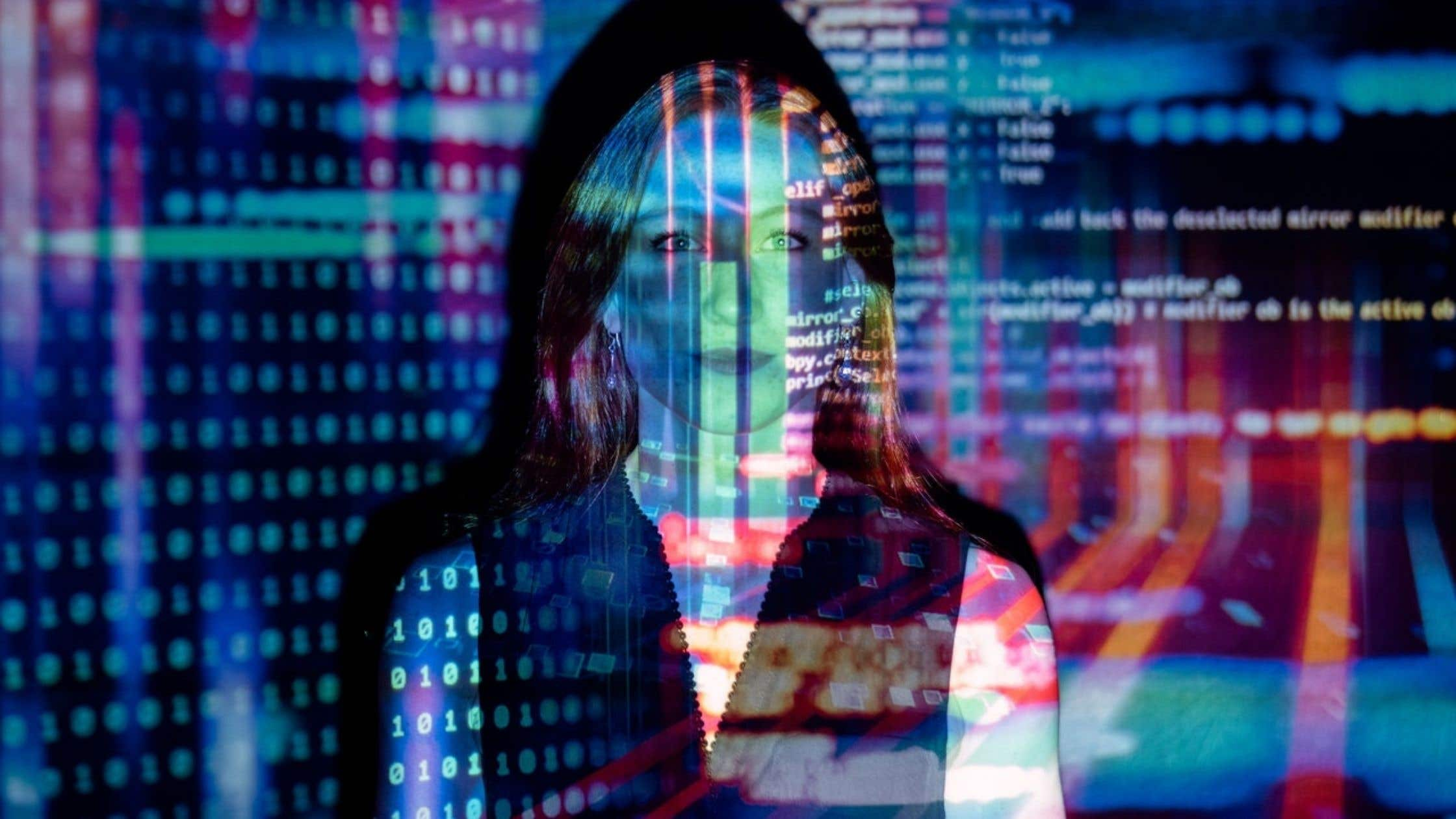 code projected onto woman