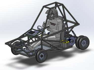 A all-electric buggy designed using avaliable and afordable components and a gravity racing vehicle. Spaceframe chasis made by welding pieces of steel pipe. Independent suspension which uses cheap moped and bicycle shock absorbers on both vehicles.