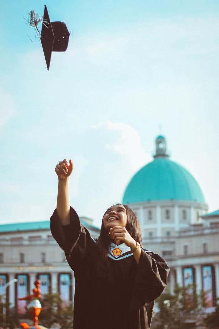 Girl throwing her cap at graduation